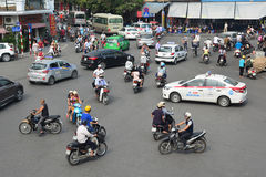 Hanoi , VIETNAM - October 25, 2015: A lot of motorcyclists and v Royalty Free Stock Photography