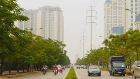 HANOI, VIETNAM - OCTOBER 13, 2016: Traffic in Hanoi on the background of skyscrapers. Traffic in Ho Chi Minh City stock footage