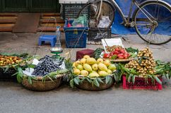 Various types of fruits selling from the traditional hanging baskets can found  in Hanoi. Stock Photos