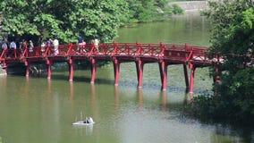 Hanoi Vietnam. People Walking over The Hu Bridge on Hoan Kiem Lake in Hanoi Vietnam stock video footage