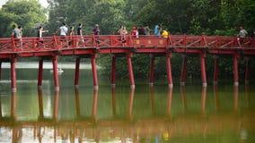 Hanoi Vietnam. People Walking over The Huc Bridge on Hoan Kiem Lake - Hanoi Vietnam stock footage