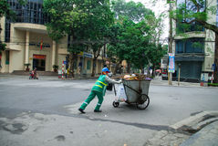 HANOI, VIETNAM - 3rd Febnuary, 2014: Workers collecting garbage on the streets of Hanoi, Vietnam Royalty Free Stock Photo