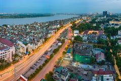 Hanoi, Vietnam - Sep 19, 2015: Aerial skyline view of Nguyen Khoai street with Vinh Tuy bridge crossing Red River on background. H. Ai Ba Trung district royalty free stock photo