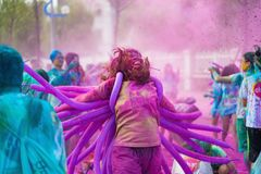 Hanoi, Vietnam - Sep 23, 2015: Blur joyful people at public color run event in Hanoi capital city. Hundreds of people joined the j. Oyful race named Color Me Run Stock Photo