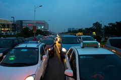 Hanoi, Vietnam - Sep 4, 2016: Cars on urban street in traffic jam at twilight in Co Linh street, Long Bien district.  Stock Image