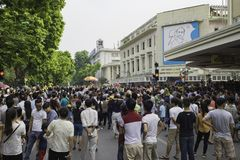 Hanoi, Vietnam - Sep 2, 2015: Crowded people on intersection by Hoan Kiem lake watching military parade on National Day.  Royalty Free Stock Photography