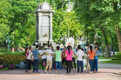 Hanoi, Vietnam - Sep 3, 2015: Group of students learning outdoor at park in Hanoi.  Stock Photos