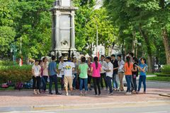 Hanoi, Vietnam - Sep 3, 2015: Group of students learning outdoor at park in Hanoi.  Royalty Free Stock Photo