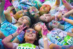 Hanoi, Vietnam - Sep 23, 2015: Group of teenagers taking photo at public color run event in Hanoi capital city. Hundreds of people. Joined the joyful race named Stock Photos