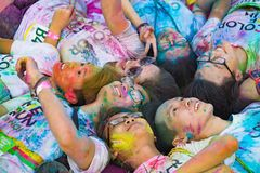 Hanoi, Vietnam - Sep 23, 2015: Group of teenagers taking photo at public color run event in Hanoi capital city. Hundreds of people. Joined the joyful race named Royalty Free Stock Photos