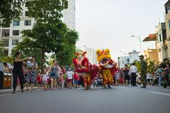 Hanoi, Vietnam - Sep 25, 2015: A show of lion dance at Times City complex in Vietnamese mid autumn festival days.  Royalty Free Stock Photography
