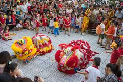 Hanoi, Vietnam - Sep 25, 2015: A show of lion dance at Times City complex in Vietnamese mid autumn festival days.  Royalty Free Stock Photos