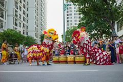 Hanoi, Vietnam - Sep 25, 2015: A show of lion dance at Times City complex in Vietnamese mid autumn festival days.  Royalty Free Stock Image