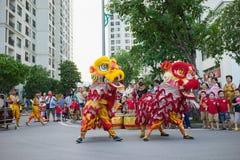 Hanoi, Vietnam - Sep 25, 2015: A show of lion dance at Times City complex in Vietnamese mid autumn festival days.  Stock Photos