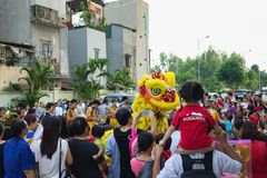 Hanoi, Vietnam - Sep 25, 2015: A show of lion dance at Times City complex in Vietnamese mid autumn festival days.  Royalty Free Stock Photo