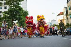 Hanoi, Vietnam - Sep 25, 2015: A show of lion dance at Times City complex in Vietnamese mid autumn festival days.  Stock Photo