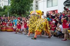 Hanoi, Vietnam - Sep 25, 2015: A show of lion dance at Times City complex in Vietnamese mid autumn festival days.  Royalty Free Stock Images