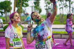 Hanoi, Vietnam - Sep 23, 2015: Two Caucasians taking selfie photo in public color run event in Hanoi capital city. Hundreds of peo. Ple joined the joyful race Stock Image