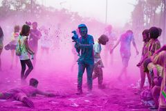 Hanoi, Vietnam - Sep 23, 2015: Well covered clothing camera man at public color run event in Hanoi capital city. Hundreds of peopl. E joined the joyful race Royalty Free Stock Images