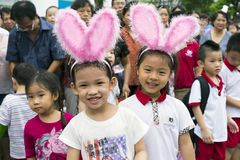 Hanoi, Vietnam - Sept 8, 2014: Children wearing rabbit hats at the show of lion dance at Times City complex on Vietnamese mid autu. Mn festival day Royalty Free Stock Photography