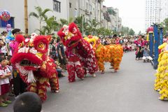 Hanoi, Vietnam - Sept 8, 2014: A show of dragon and lion dance performed at lunar mid autumn festival at Times City Complex. This. Is a form of traditional Royalty Free Stock Images