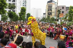 Hanoi, Vietnam - Sept 8, 2014: A show of dragon and lion dance performed at lunar mid autumn festival at Times City Complex. This. Is a form of traditional Stock Photos