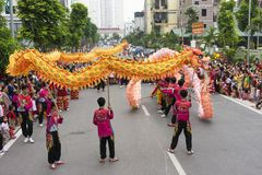 Hanoi, Vietnam - Sept 8, 2014: A show of dragon and lion dance performed at lunar mid autumn festival at Times City Complex. This. Is a form of traditional Royalty Free Stock Photos