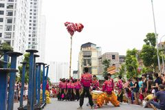 Hanoi, Vietnam - Sept 8, 2014: A show of dragon and lion dance performed at lunar mid autumn festival at Times City Complex. This. Is a form of traditional Royalty Free Stock Photo