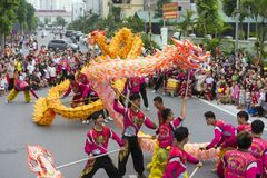 Hanoi, Vietnam - Sept 8, 2014: A show of dragon and lion dance performed at lunar mid autumn festival at Times City Complex. This. Is a form of traditional Stock Photo
