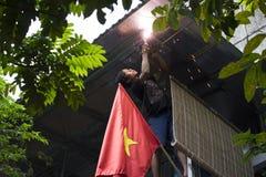 Hanoi, Vietnam - Sept 21, 2014: A welder fixing the house on Hanoi street.  Royalty Free Stock Photography