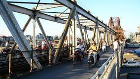 Hanoi Vietnam. Time Lapse of Mopeds Crossing  a Train Bridge Daytime - Hanoi Vietnam stock video