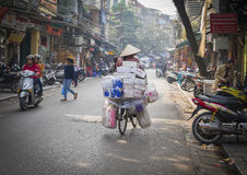Hanoi Woman Riding Filled Bike, Vietnam Royalty Free Stock Image