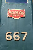 Hanomag nameplate. Nameplate and number of heavy tank locomotive Vr-1 No 667 closeup. Kotka, Finland Royalty Free Stock Photos