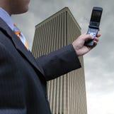 hans affärsmanmobiltelefon Fotografering för Bildbyråer
