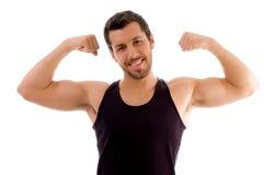 hans starka manmuskeluppvisning Fotografering för Bildbyråer