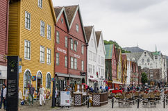 Hanseatic Houses. BERGEN, NORWAY - JUNE 5: Tourists walking on the UNESCO World Heritage Site, Bryggen, in the city of Bergen, on June 5, 2014. Bryggen is famous Royalty Free Stock Image