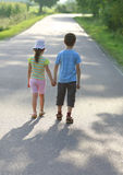 Hansel and Gretel. Road to sun, children love, hold hands Royalty Free Stock Image
