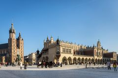 Hansom cab on Old Town square in Krakow, Poland. KRAKOW, POLAND - MARCH 13: Hansom cab waiting to whisk tourists around the beautiful city of Krakow on March 13 stock photography