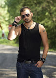 Hansom tattooed man with sunglasses. In nature stock photo