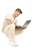 Hansome casual man with laptop Royalty Free Stock Photos