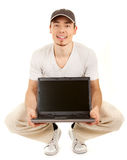 Hansome casual man with open laptop Stock Images