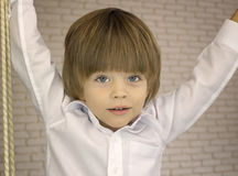 Hansome little boy in a white shirt Royalty Free Stock Photo