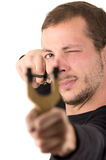 Hansome man concentrated aiming a slingshot Royalty Free Stock Photography