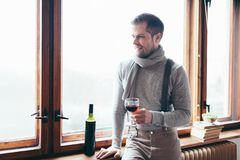 Hansome man enjoying a glass of red wine. Hansome man enjoying a glass of good red wine Royalty Free Stock Photos