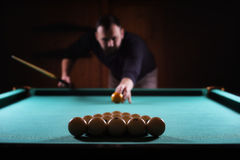 Hansome man playing billiards alone Royalty Free Stock Photo