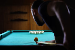 Hansome man playing billiards alone Stock Photos