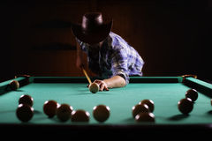Hansome man playing billiards alone Stock Image