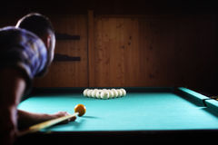 Hansome man playing billiards alone Stock Images