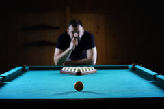 Hansome man playing billiards alone Stock Photography