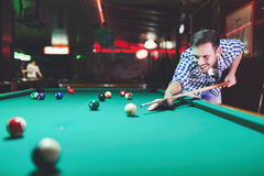 Hansome man playing pool in bar alone Stock Image